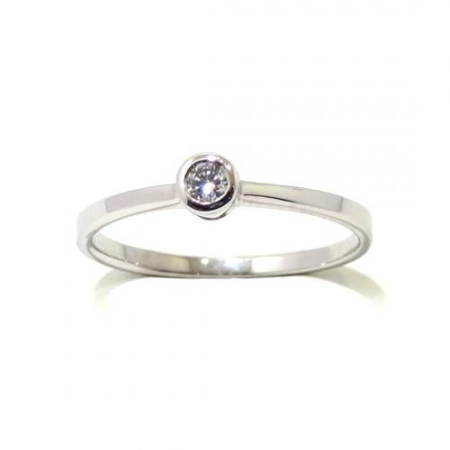 Anillo solitario oro blanco 18K diamante talla brillante en chaton 0,05 ct