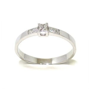 Anillo solitario oro blanco 18K diamante talla princesa 0,12 ct con diamantes